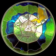 """Autonomous stained glass: """"Platonic Plaything"""", 2.5' diameter, location unknown."""