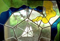 "Autonomous stained glass: ""Platonic Plaything"", 2.5' diameter, location unknown."