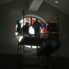 "Installation of West Window, ""Reach Out"" stained glass window."