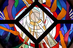 "Detail: west stained glass window, ""Reach Out"". Made from German mouthblown glass."