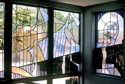 Corner view of 3 of 7 windows made with German mouthblown glass.