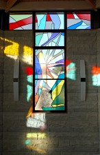 Southwest window at sunrise. Made with imported mouthblown glass and prisms.