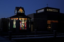 Night view: St. Michael Chapel with the main sanctuary at right.