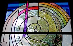 """History"" stained glass window: German mouthblown glass, dichroic glass, prism."