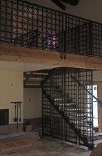 "Temporary photo of ""Oasis Cross"" and wrought iron stairwell during renovation/construction."