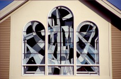 """Trinity Triptych"" above Main Entrance: Exterior view of reflective German opal glass."