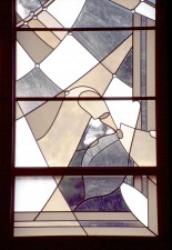 "Detail: ""Trinity Triptych: Father"" stained glass with Garden of Eden symbols."