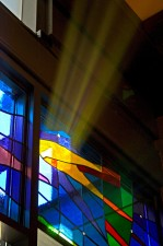 "Morning sun on ""SWFLW"" stained glass with German mouthblown glass and prisms."