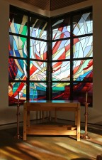 """Creation"": a stained glass window of imported mouthblown German glass."