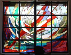 """Creation"": a stained glass window of imported mouthblown German glass (composite photo)."