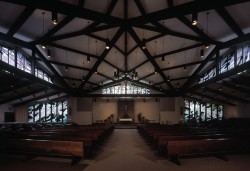 "View from Baptistry to Altar: ""Creation"" Clerestory flanked by ""God's Gift's"" Windows"