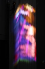 Light patterns projected onto fluted column from Narthex stained glass window.